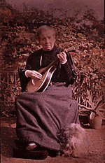 Sarah Acland with her Portuguese guitar and dog (self-portrait).jpg
