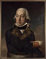 Painting of a man in a dark blue military coat of the 1790s with gold lace trim. He wears a white wig with hair curled at the ears and points to the viewer's right.