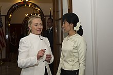 Clinton standing with Aung San Suu Kyi