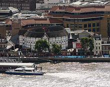 The reconstructed Globe Theatre on the south bank of the River Thames in London (Source: Wikimedia)