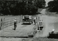 Sharkey County, Miss. June 1, 1965. Sunflower River Ferry is used by Ed Blake and Austin McMurchy on a field trip in the delta.png