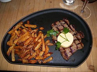 Sirloin steak - Sirloin steak, served with garlic butter and chips