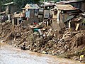 Slum in Manila during flooding (4046572466).jpg