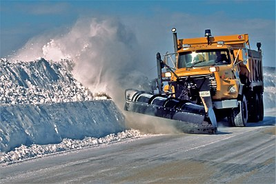 A winter service vehicle clearing roads near Toronto, Ontario, Canada.