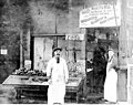 Solomon Calvo (left) and Fred August in front of the Waterfront Fish and Oyster Co, Pike Place Market, Seattle, ca 1918 (PORTRAITS 475).jpg