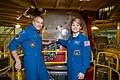 Soyuz MS-11 David Saint-Jacques and Anne McClain in front of their spacecraft.jpg