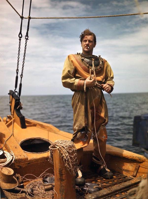 Sponge diver John M. Gonatos putting on his diving suit