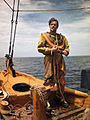 Sponge diver John M. Gonatos putting on his diving suit.jpg