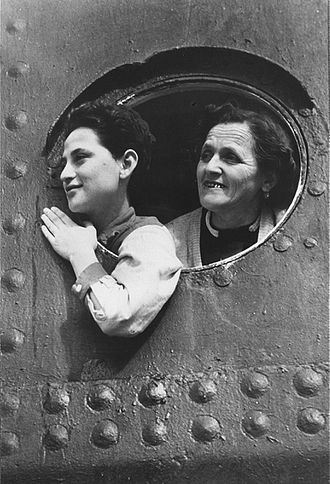 Expulsions of Jews - Jewish refugees look out through the portholes of a ship while docked in the port of Haifa.