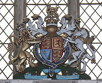 Royal coat of arms of the United Kingdom - The current version of the Royal Arms, displayed in the parish church of Stone, Kent.