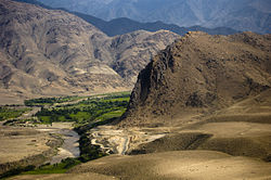 Lush greenery stands in stark contrast to the surrounding desert in Laghman Province