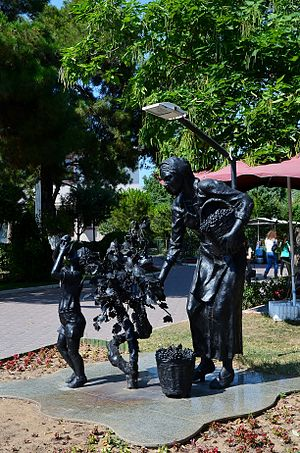 Kırklareli Province - Statue of wine grape harvesting woman with child in downtown Kırklareli.