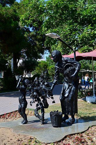 Kırklareli Province - Statue of wine grape harvesting woman with child in downtown Kırklareli.
