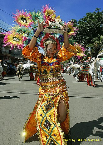 Subanon people - A Subanen lead dancer carrying St. James image during the Kinabayo Festival