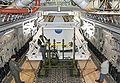 Technicians carefully position an Orion flight test crew module.jpg
