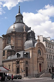 A picture of the architecturally impressive Temple du Marais as seen from the street.