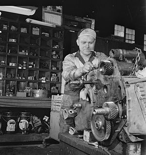 Tennessee Coach Company - A mechanic rebuilding a bus engine at the TCC garage in Knoxville, 1943 by Esther Bubley.