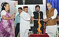 """Thaawar Chand Gehlot lighting the lamp at the launch of the """"First Indian Sign Language (ISL) Dictionary of 3000 words"""", developed by the Indian Sign Language Research & Training Centre under Mo Social Justice & Empowerment.jpg"""
