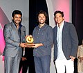 The Actor, Surya presenting the award for the Best Film to the Director, Mr. Alejandro Landes and the Producer.jpg