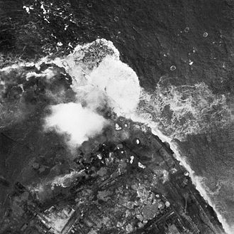 Operation Infatuate - The battle for Walcheren Island: An aerial photograph of bombs exploding on the Walcheren dyke, the Netherlands during RAF Bomber Command's raid on the island.