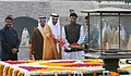 The Crown Prince of Abu Dhabi, Deputy Supreme Commander of U.A.E. Armed Forces, General Sheikh Mohammed Bin Zayed Al Nahyan paying floral tributes at the Samadhi of Mahatma Gandhi, at Rajghat, in Delhi.jpg
