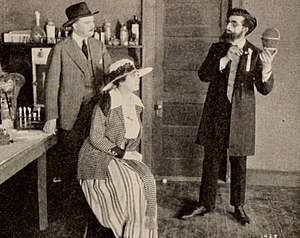 William Bailey (actor) - Still from the film serial The Eagle's Eye (1918) with Fred C. Jones, Marguerite Snow, and William Bailey