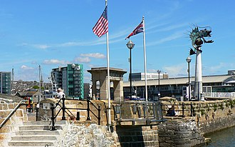 Sutton Harbour - The West Pier of Sutton Harbour, showing the Mayflower Steps and The Leviathan sculpture.