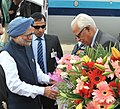 The Prime Minister, Dr. Manmohan Singh being received by the Governor of Jammu and Kashmir, Shri N.N. Vohra, on his arrival at Jammu airport on February 02, 2014.jpg