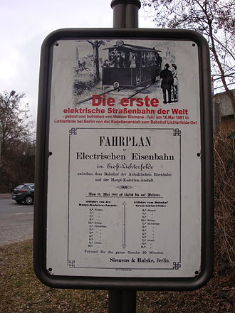 Gross-Lichterfelde Tramway - A photo of a plaque raised in Lichterfelde, Berlin, Germany, to mark the world's first electric streetcar line. The plaque is located on a stand near the Lichterfede Ost Railway Station in Berlin, Germany.