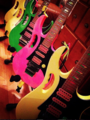 Three original 1987 Ibanez JEM 777 guitars.png
