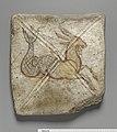 Tile with capricorn.jpg