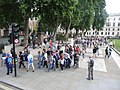 Tourists in Parliament Square, London.jpg