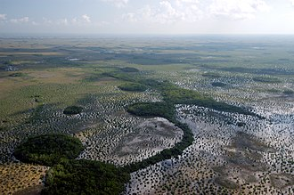 Fresh water - Rivers, lakes, and marshlands, such as (from top) South America's Amazon River, Russia's Lake Baikal, and the Everglades in the United States, are types of freshwater systems.