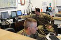 U.S. Air Force Senior Airmen Zachary Sura, front, and Jonathan Twyman, both weather forecasters with the 455th Expeditionary Operations Support Squadron, monitor weather patterns in the squadron's weather flight 130501-F-ZX232-002.jpg