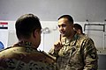U.S. Army Capt. Syed Ali, right, with the Regional Communications Center, Combined Joint Task Force (CJTF), 101st Airborne Division, asks about a medical procedure at the El Salam Egyptian Field Hospital 130827-A-YW808-029.jpg