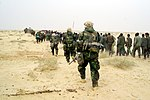 U.S. Marines with Iraqi POWs - March 21, 2003.jpg