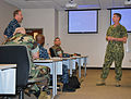 U.S. Navy Rear Adm. Mark Handley, right, commander, 1st Naval Construction Division, fields a question during the sexual assault prevention and response workshop at Naval Construction Battalion Center Gulfport 100803-N-BI488-844.jpg