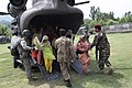U.S. and Pakistani service members help civilians exit a U.S. Army CH-47 Chinook helicopter in Khwazahkela, Afghanistan.jpg