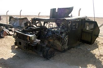 Humvee struck by an improvised explosive device attack in Iraq on 29 September 2004. Staff Sgt. Michael F. Barrett, a military policeman in Marine Wing Support Squadron 373, was severely injured in the attack. USMC-15618.jpg