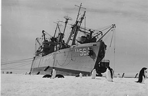 USS Arneb (AKA-56) - USS Arneb listing to repair ice damage to the hull in 1957.