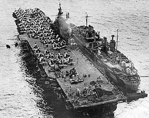 USS Jason (AR-8) - Jason assisting USS ''Randolph'' after a Kamikaze hit at Ulithi, 1945.Photographed from a USS Miami (CL-89) floatplane