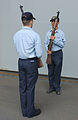 US Navy 030707-N-8148A-025 Electronics Technician 2nd Class Paul Adamez and Operations Specialist 2nd Class Gary Pineda practice rifle drills as part of color guard duties for the ship's commissioning ceremony, scheduled for Ju.jpg