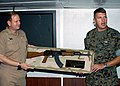 US Navy 030924-N-9109V-001 presents an AK-47 rifle to USS Saipan (LHA 2).jpg