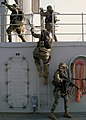 US Navy 031018-N-1693W-002 The 2nd Fleet Anti-Terrorism Team (FAST), 7th Platoon, provides cover for fellow Marines as they take up positions aboard USS Blue Ridge (LCC 19) during a mock anti-terrorism boarding exercise.jpg