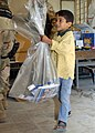 US Navy 040227-N-0401E-002 Children from Umm Qasr primary and secondary schools collect school supplies provided by Commander, U.S. Naval Forces Central Command-U.S. Fifth Fleet.jpg
