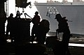 US Navy 040411-N-9851B-009 Sailors aboard the nuclear powered aircraft carrier USS Harry S. Truman (CVN 75) retrieve cargo transferred from the Military Sealift Command (MSC) underway replenishment oiler USNS Laramie (T-AO 203).jpg