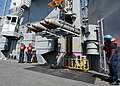 US Navy 040423-N-4190W-014 Deck department personnel aboard the fast combat support ship USS Seattle (AOE 3) transport ammunition to USS John F. Kennedy (CV 67).jpg
