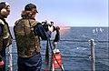 US Navy 040616-N-1810F-006 A Midshipman 3rd Class fires a GAUSE-17-A gattling gun.jpg