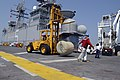 US Navy 050903-N-8154G-040 Crash and Salvage crew members aboard amphibious assault ship USS Bataan (LHD 5) move a 500 gallon rubber bladder filled with fresh drinking water for Hurricane Katrina relief efforts.jpg