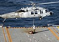 US Navy 060313-N-8547M-005 Flight deck personnel attach a cargo pendant to a MH-60S Seahawk helicopter on the flight deck aboard the amphibious assault ship USS Saipan (LHA 2).jpg